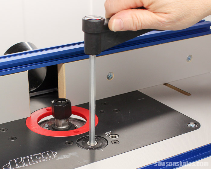 The micro-adjustment dial on the Kreg Precision Router Lift raises and lowers the router.