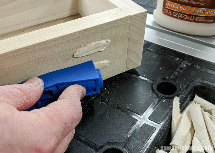 The pocket holes in the ultimate workbench were filled with pocket hole plugs that were inserted with the Kreg Jig Mini