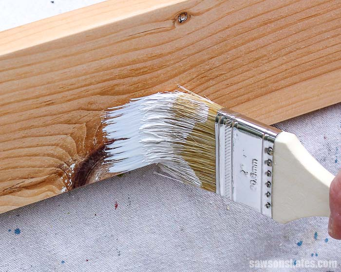 BIN primer is applied to seal knots to prevent them from bleeding through the paint