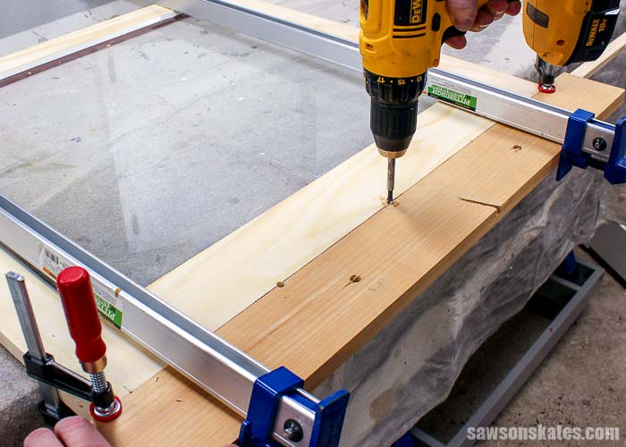 Weep holes are drilled in the bottom of DIY wood storm windows to allow water to escape