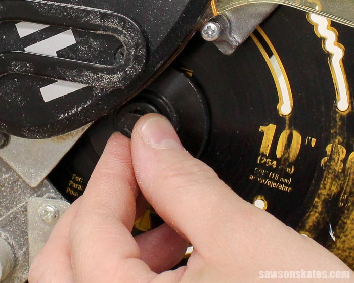 Replace the spindle bolt on the miter saw and tighten with a wrench
