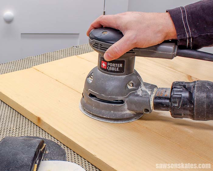 A random orbit sander is a woodworking tool every beginner should have to smooth rough wood.