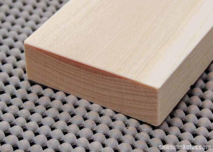 Using sandpaper to ease the edges of furniture projects prevents denting and gives the piece a finished look