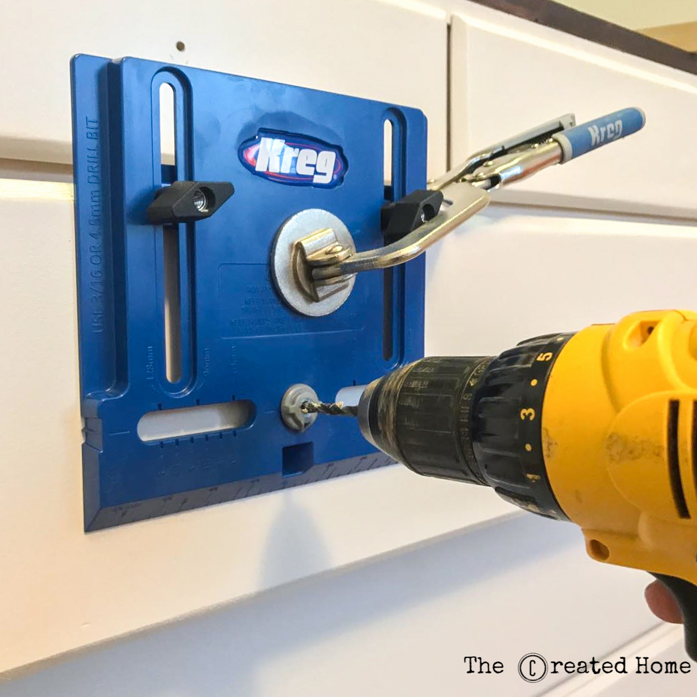 Using cabinet building tools like a Kreg Hardware Jig makes quick work of drilling holes for pulls and knobs