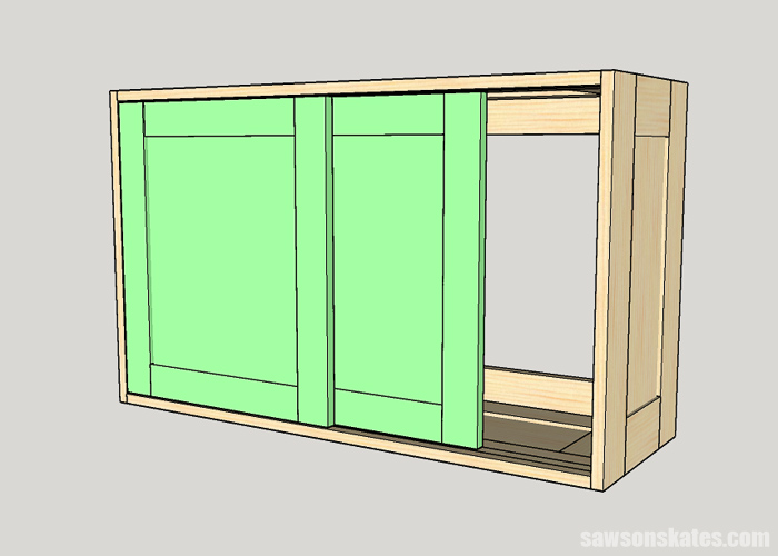 Installing the second sliding door in a DIY tool storage cabinet