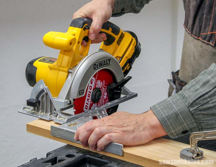 Using a speed square to make a cut with a circular saw