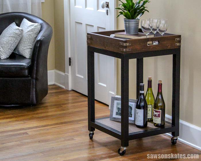 Learn how to build a DIY Bar Cart! It's easy to make with these free plans. It features a wood removable tray and aged metal hardware for an industrial look.