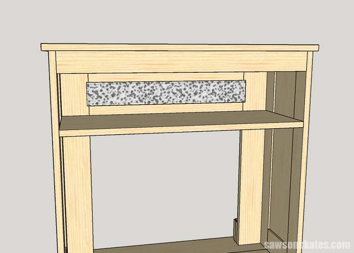 Installing the glass in the DIY electric fireplace mantel and TV stand