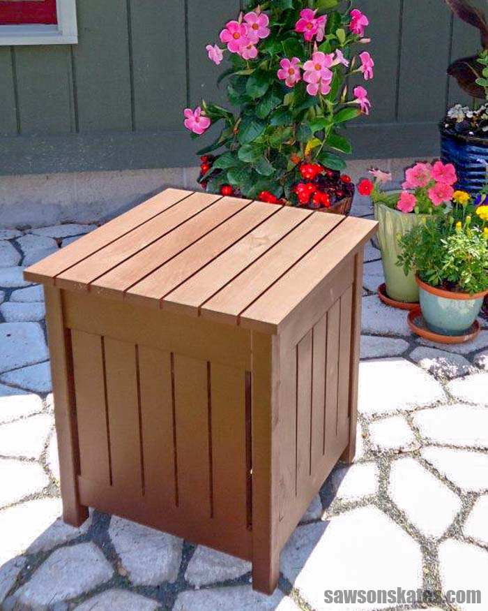 Build your own DIY Outdoor Side Table with these free plans! This simple table is made with wood and features a small cooler for chilling drinks.