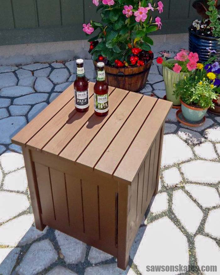 DIY outdoor side table with two beer bottles