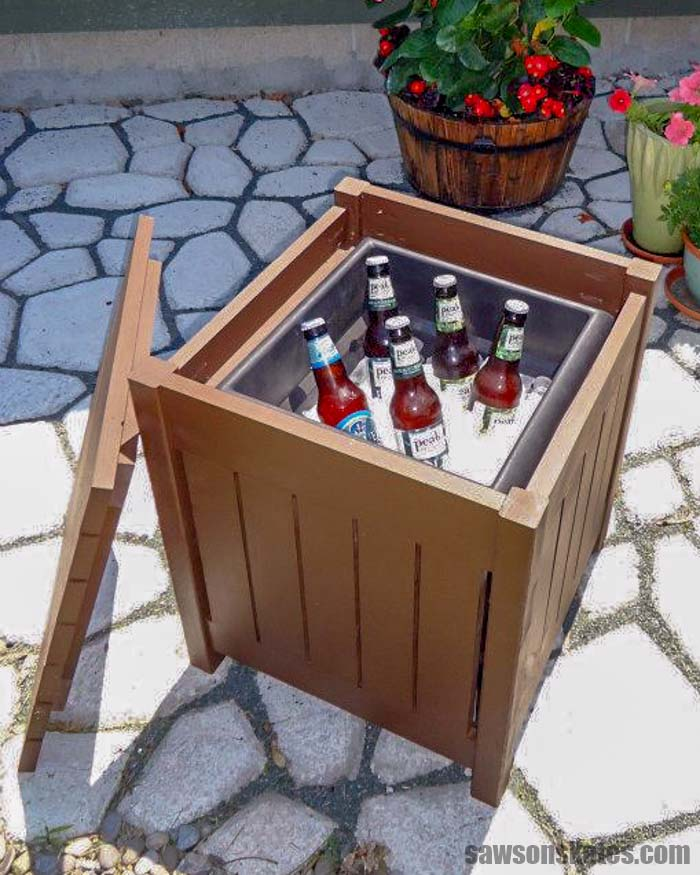 DIY outdoor side table with the top removed to reveal the color filled with beer