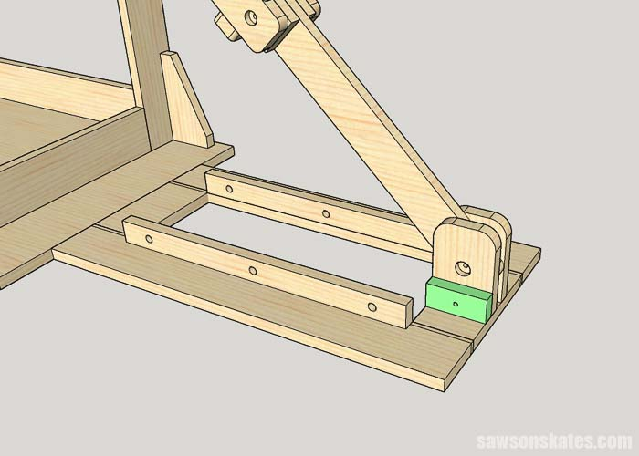 Screwing a stop block on a mobile miter saw station