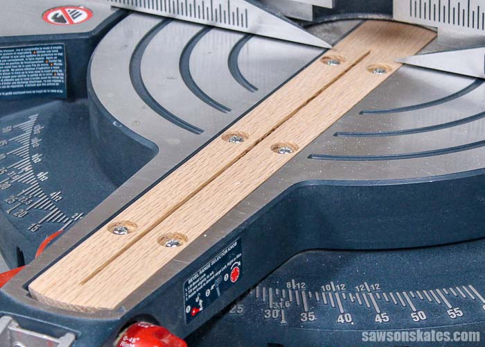 A zero clearance insert reduces tear-out and helps us make cleaner miter saw cuts. We can buy an insert but it's easy to make a DIY insert with scrap wood.
