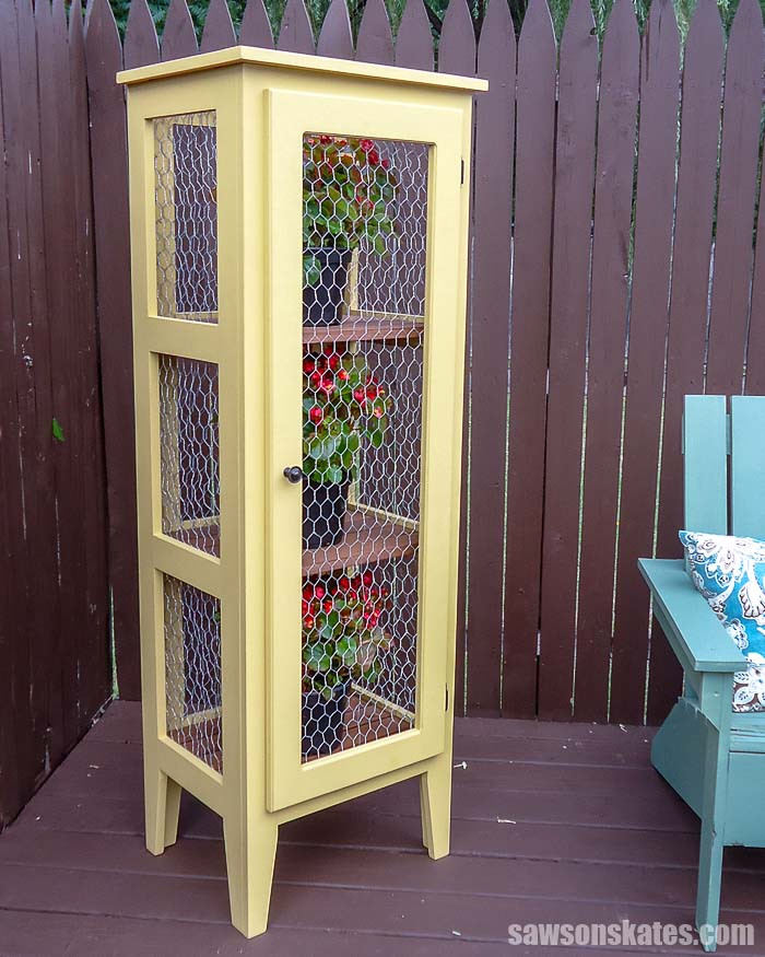 Get your Kreg Jig and make this creative DIY Outdoor Plant Stand! These patio cabinet plans show how to build a tiered wooden display for multiple plants!