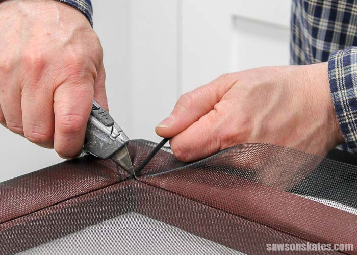 Cutting the excess spline when replacing a window screen