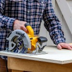 Cutting a straight line on a piece of plywood with a circular saw