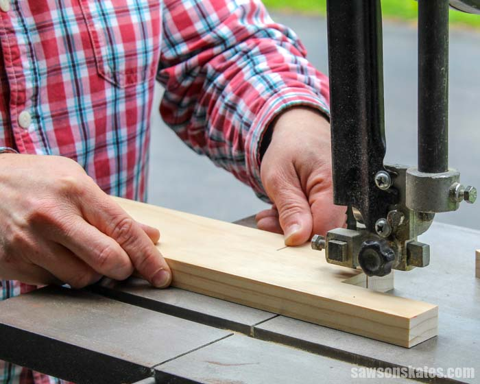 Using a bandsaw to cut a window prop stick to fix a window that won't stay up