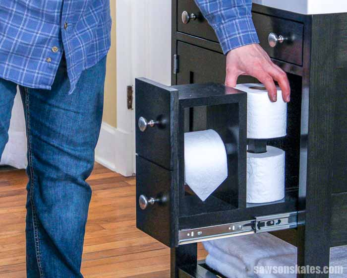 This DIY bathroom vanity has a hidden toilet paper holder