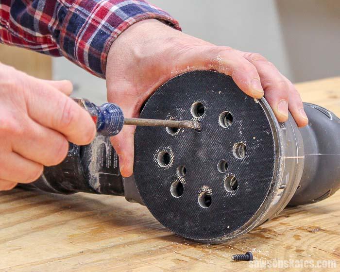 Loosen the screws from the sander pad of my orbital sander