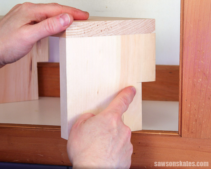 Showing a cutout at the back of a DIY cabinet organizer shelf