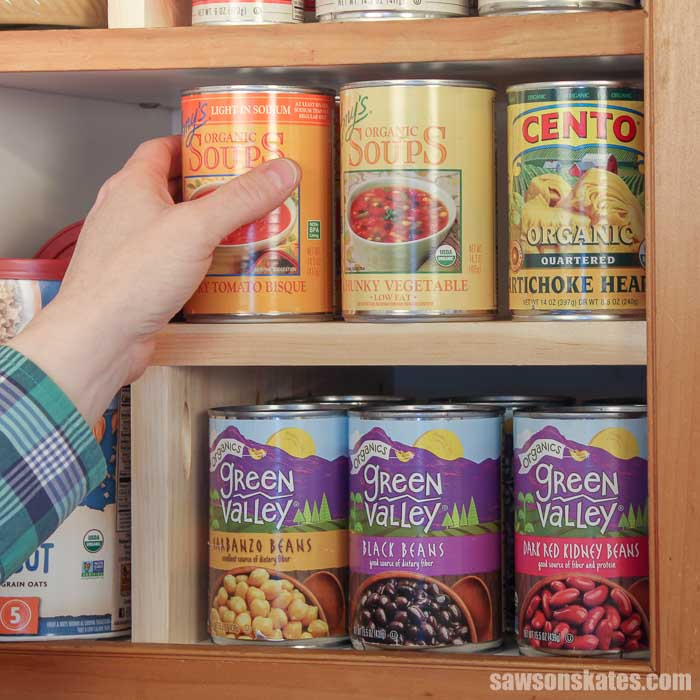 Add extra storage and get organized now with this DIY cabinet organizer shelf! It's a cheap and easy project that can be made with scrap wood and a few basic tools.