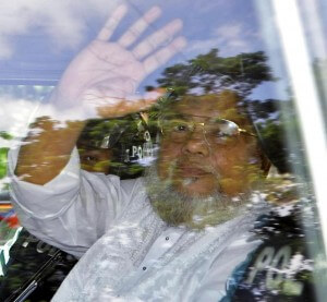 FILE - In this July 17, 2013, file photo, Jamaat-e-Islami Secretary General Ali Ahsan Mohammad Mujahid waves from a police vehicle as he is brought to court in Dhaka, Bangladesh. Senior Jail Superintendent Mohammad Jahangir Kabir told The Associated Press early Sunday, Nov. 22, 2015, that Bangladesh Nationalist Party leader Salahuddin Quader Chowdhury and Ali Ahsan Mohammad Mujahid were executed, for committing war crimes during the country's 1971 independence war against Pakistan, at Dhaka Central Jail in the nation's capital. (AP Photo, File)
