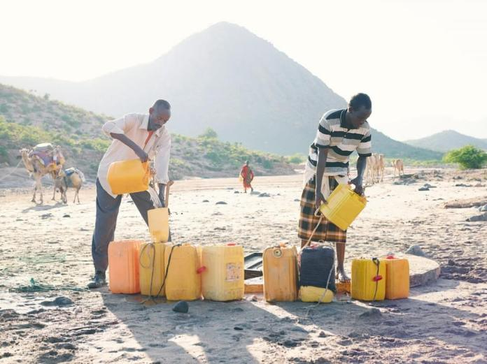 Men drawing water from a well in Bodaale, Somaliland
