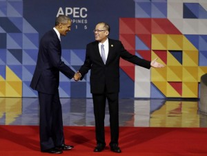U.S. President Barack Obama, left, is welcomed to the opening plenary session by Philippines President Benigno Aquino III at the Asia-Pacific Economic Cooperation (APEC) Summit in Manila, Philippines, Thursday, Nov. 19, 2015. Asia-Pacific leaders called Thursday for increased international cooperation in the fight against terrorism as they held annual talks overshadowed by the Paris attacks. (Mast Irham/Pool Photo via AP)