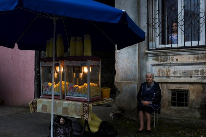 Lyuba Agrba, 79, sells popcorn across from Dinamo Stadium before  the beginning of the CONIFA World Football Cup on May 29, 2016 in Sukhumi, Abkhazia.