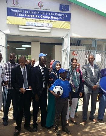 Inauguration participants outside the generator shed. Photo: UNOPS/Joshua Okoth