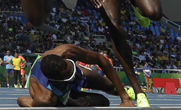 AP - Hassan Mead fell during the final lap of the 5,00-meter run Wednesday