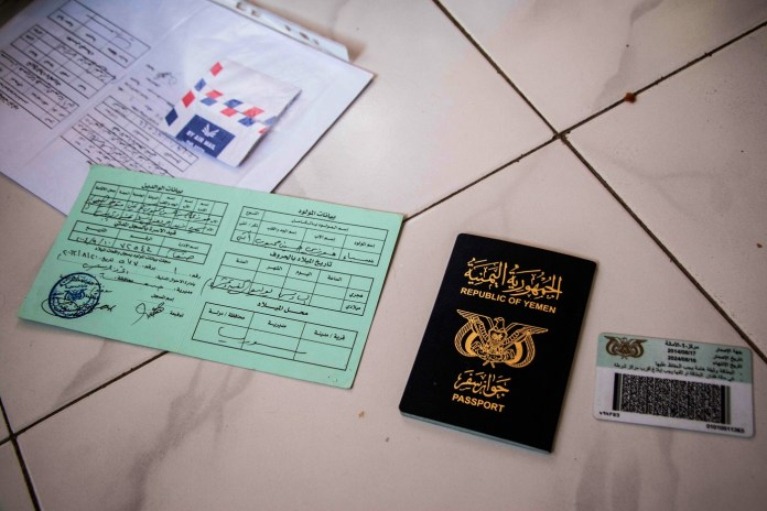 Nizar Foazi's identification documents and Yemeni passport. He says many Yemenis and Somali-Yemenis have fled to Somaliland without their ID documents because they had to run away so quickly. (Ashley Hamer)