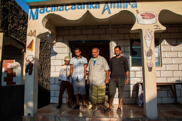 Yemeni business owners stand in front of their shop in Hargeisa. Yemeni migrants have been traveling to Somaliland for work opportunities well before the conflict in Yemen. (Ashley Hamer)