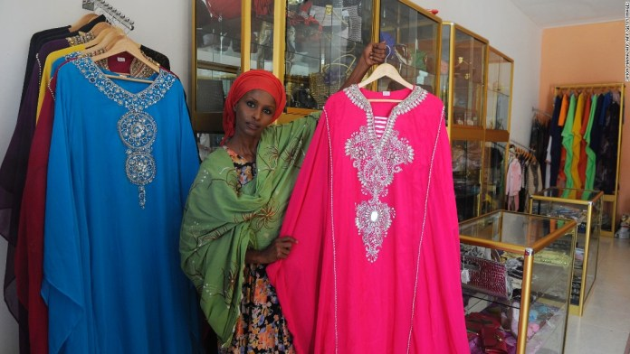 Photos: New member in family of nations? Ayan Hussein, a London stylist originally from Somaliland, shows dresses she sells to local Muslim women, inside her clothing store in Hargeisa. Hussein is one of many immigrants who have found their way back to the relative calm of Somaliland.