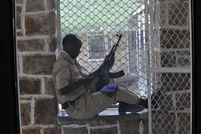 A Somaliland prison warden sitting guard in Hargeisa