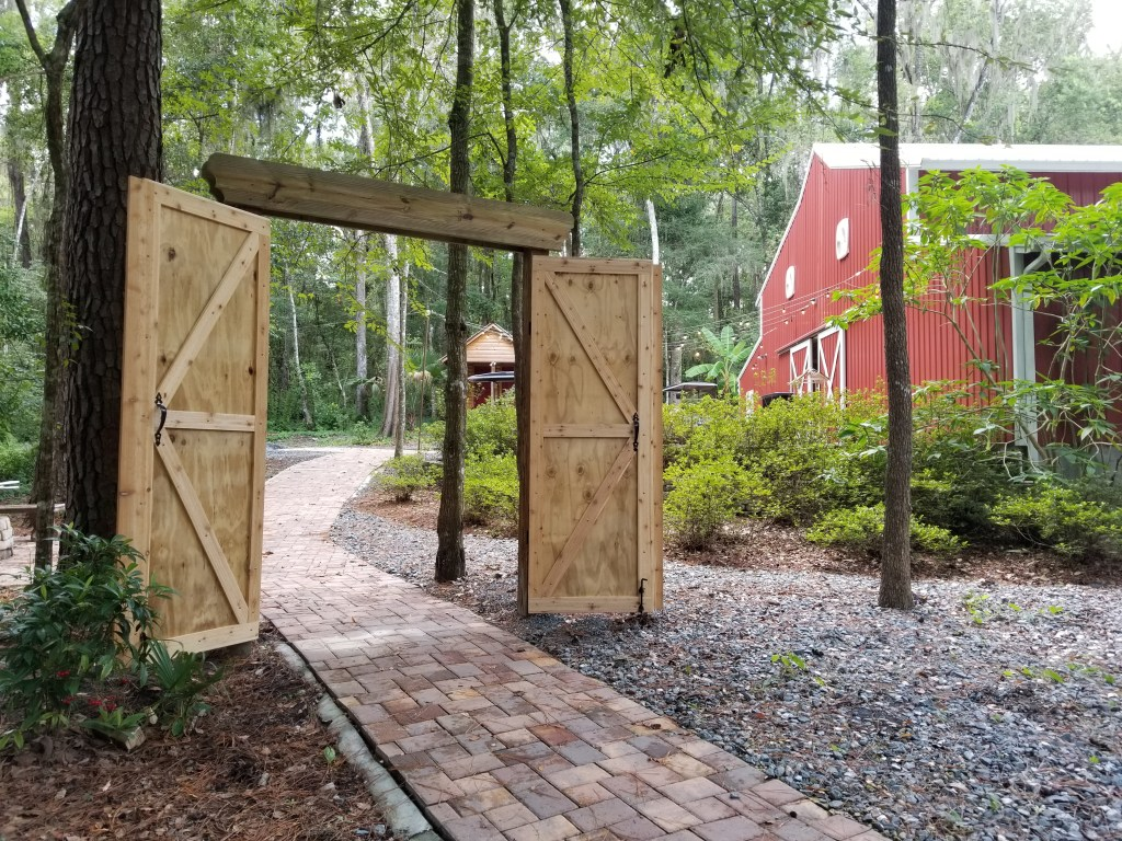 The opening gate at the Shabby Chic Wedding Barn. The most elegant place for a Florida barn wedding.