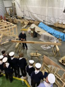 Being shown how to work the keel