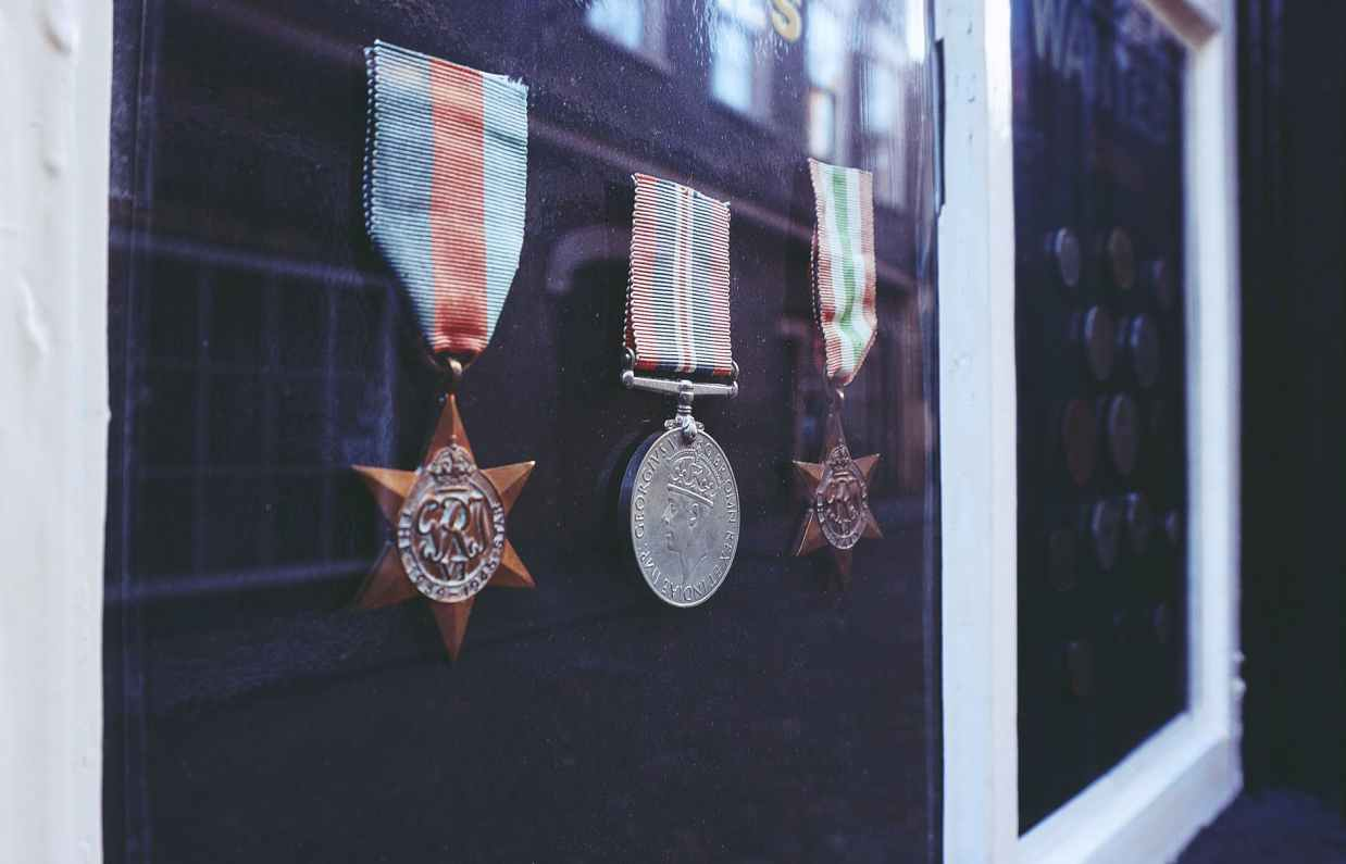 three medals in glass enclosure