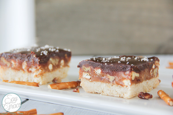 These delicious buttery shortbread squares layered with salted caramel are packed with pecans and pretzels then finished with a yummy layer of chocolate.