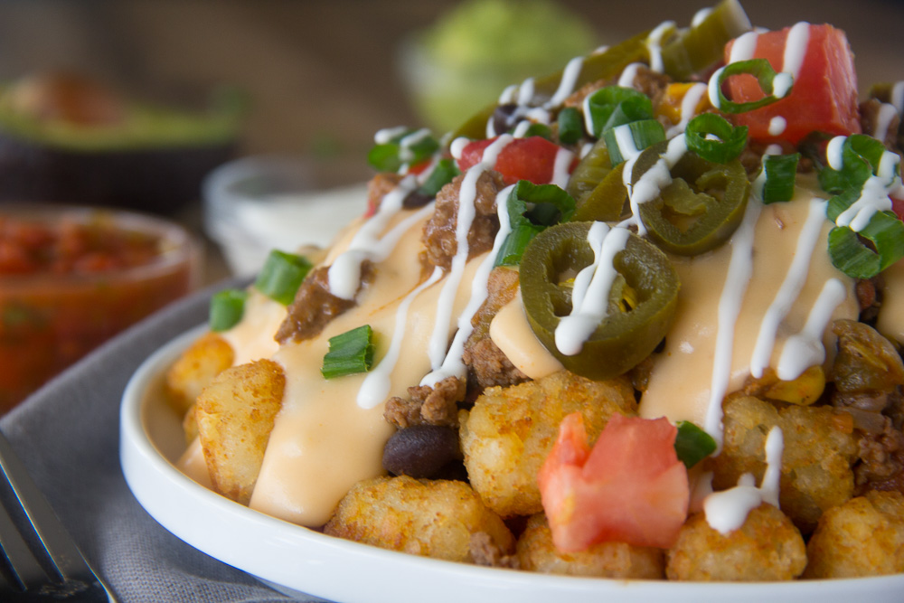 This fun tater tot twist on traditional nachos with all the fixins' is sure to please all of your game day guests!!