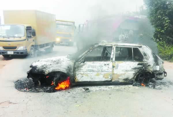 FUNAAB students protest robbery attacks, burn vehicles