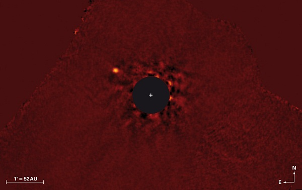 Near infrared image of Kappa Andromedae system with the star being covered and Super-Jupiter κ And b visible at the upper left  (Credit: NAOJ / Subaru / J. Carson (College of Charleston) / T. Currie (University Toronto))