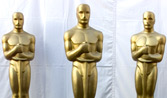 Three of Hugh Jackman's henchmen disguised as Oscars helped rig the balloting backstage (Note: photo nabbed from Oscar's offiicial web site and I'll be damned if they think I'm giving it back.)