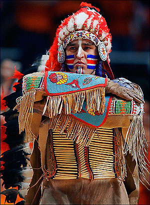 "Chief Illiniwek: ""Read my face paint:  I am not a racist mascot."""