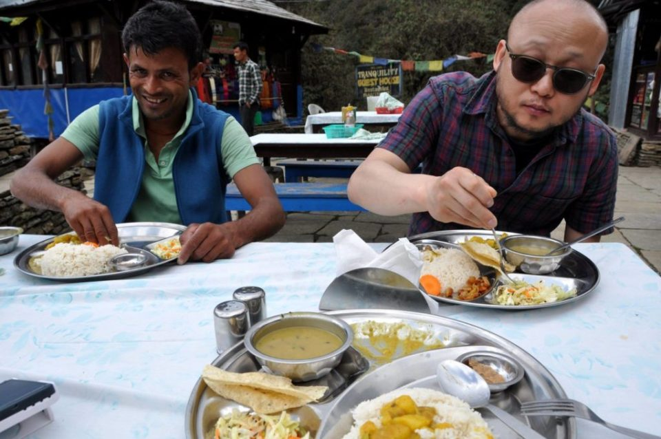 Eating dhal bhat at one of the lunch stops on the Poon Hill trail