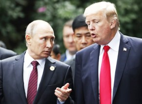 Vladimir Putin and Donald Trump at a summit in 2017 in Vietnam, where Trump assured reporters he believed the Russian leader's claim that he had not interfered in the 2016 election.