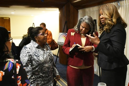 People ask mortgage and homeownership questions after Johnson speaks at the recent Stateswomen for Justice Luncheon. PHOTO: Roy Lewis