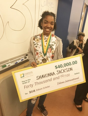 Shavonna Jackson poses with her $40,000 Edison scholarship she'll use to pursue studies in STEM fields.