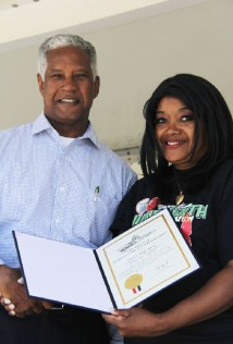 Curt Lewis presented a 'Certificate of Special Congressional Recognition' to the granddaughter of Israel Beal. Credit: John Coleman909 894-3070 Community Photography X (C P Time/s)