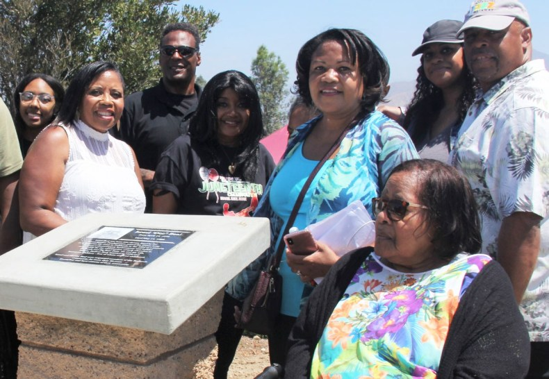 Members of the Israel Beal family gathered around the Israel Beal Memorial. Credit: John Coleman909 894-3070 Community Photography X (C P Time/s)